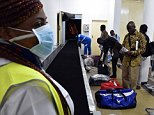 Passengers arriving from Conakry in Guinea wait for their luggages at the airport in Abidjan on October 20, 2014 as Ivory Coast's airline resumed flights to the three west African countries worst-hit by Ebola -- Guinea, Liberia and Sierra Leone. The worst-ever outbreak of the deadly virus has killed more than 4,500 people, almost all in west Africa, with close to 2,500 deaths registered in Liberia alone. AFP PHOTO / ISSOUF SANOGOISSOUF SANOGO/AFP/Getty Images