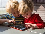 Two Brothers playing on an iPad.  DFGC4B