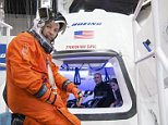 In this undated image provided by NASA, astronaut Randy Bresnik prepares to enter The Boeing Company's CST-100 spacecraft for a fit check evaluation at the company's Houston Product Support Center. On Tuesday, Sept. 16, 2014, NASA will announce which one or two private companies wins the right to transport astronauts to the International Space Station. The deal will end NASA's expensive reliance on Russian crew transport. The contenders include SpaceX, Sierra Nevada Corp., and Boeing. (AP Photo/NASA)
