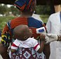 A health worker checks the temperature of a baby entering Mali from Guinea at the border in Kouremale, October 2, 2014. The worst Ebola outbreak on record was first confirmed in Guinea in March but it has since spread across most of Liberia and Sierra Leone, killing more than 3,300 people, overwhelming weak health systems and crippling fragile economies. REUTERS/Joe Penney (MALI - Tags: DISASTER HEALTH) - RTR48PQ8