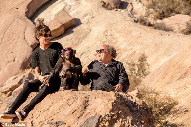Controversy: PETA have asked for scenes containing a chimpanzee to be removed from One Direction's new video for Steal My Girl, which features band-mamber Louis Tomlinson and Danny Devito