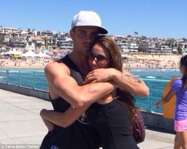 'Really missing him': In August, Carrie shared this sweet snap of the two of them cuddling at the beach