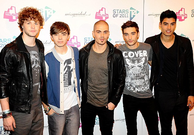 No hair there: Max George, centre, with his The Wanted band mates as we are used to seeing him