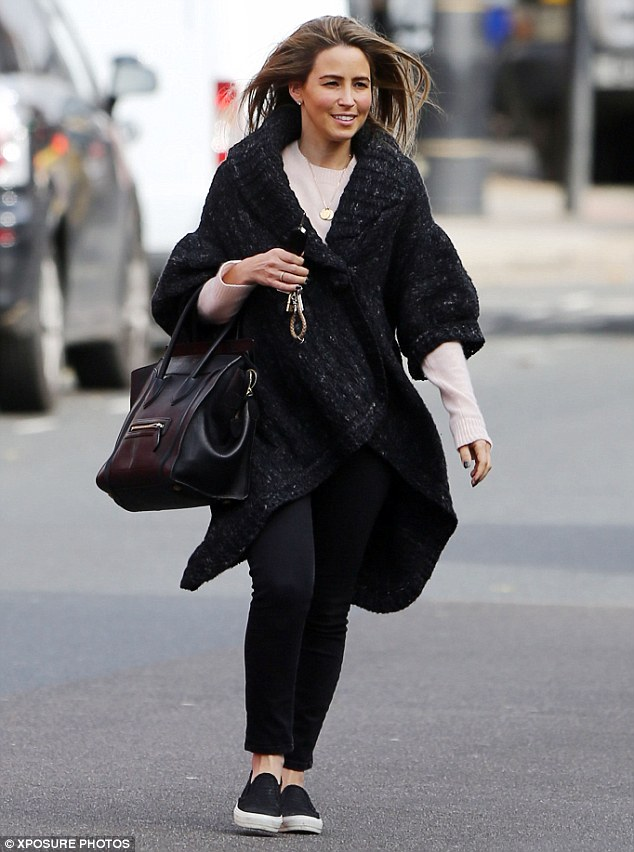 Spring in her step: Rachel Stevens couldn't have looked happier as she bounded around Notting Hill, the day after it was announced that she is reuniting with her S Club 7 band mates for Children In Need in November