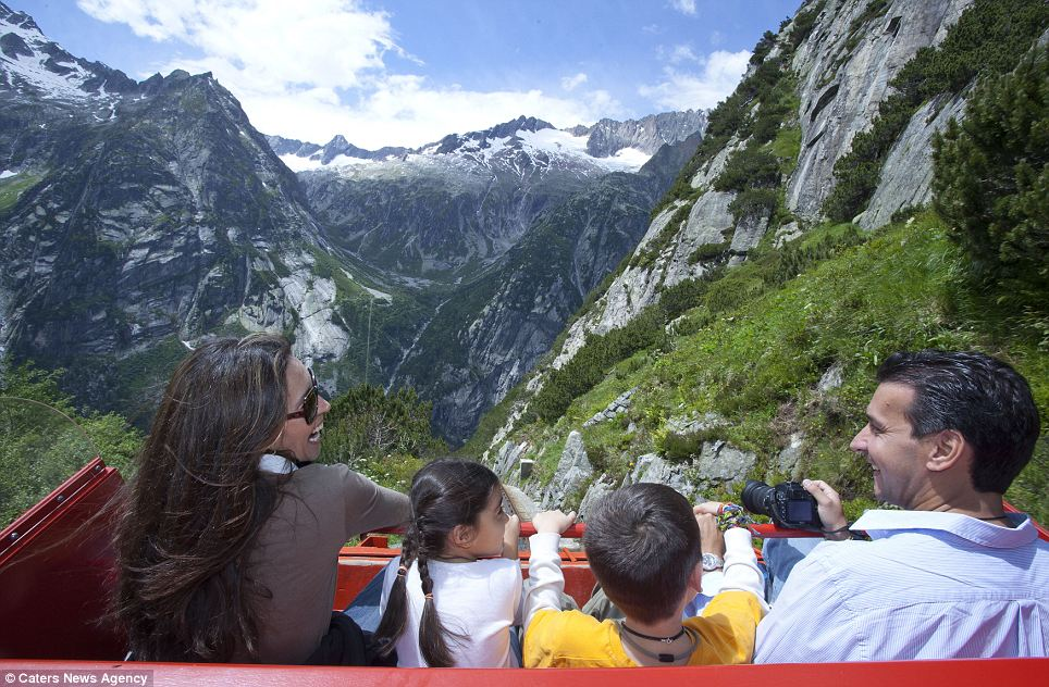 Scenic: Open carriages take 24 passengers up the steep cliff face from Handegg, in Hasli Valley, on scary but scenic ride lasting about 12 minutes