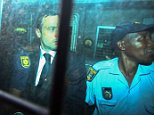 epa04455911 Members of the South African Police Service with Oscar Pistorius (L) in the back of an armoured police vehicle as he is transported away from the High Court  in Pretoria, South Africa 21 October 2014. Oscar Pistorius was sentenced to 5 years in prison after being convicted of culpable homicide for his part in the shooting of his model girlfriend Reeva Steenkamp in February 2013.  EPA/KEVIN SUTHERLAND
