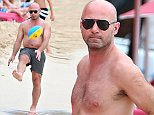 EXCLUSIVE: Footballer Alan Shearer is pictured frolicking on the beach while on holiday in Barbados.  Pictured: Alan Shearer Ref: SPL872622  231014   EXCLUSIVE Picture by: PRIMADONNA/GEMAIRA / Splash News  Splash News and Pictures Los Angeles: 310-821-2666 New York: 212-619-2666 London: 870-934-2666 photodesk@splashnews.com