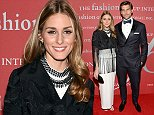 """Olivia Palermo and husband Johannes Huebl attend Fashion Group International's 31st Annual """"Night of Stars"""" at Cipriani Wall Street on Thursday, Oct. 23, 2014 in New York. (Photo by Evan Agostini/Invision/AP)"""