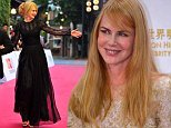 Alamy Live News. E9BWDJ Haikou, China's Hainan province. 24th Oct, 2014. Australian actress Nicole Kidman (R) greets the audience at the red carpet ceremony of the 2014 Mission Hill World Celebrity Pro-Am golf tournament in Haikou, capital of south China's Hainan province, Oct. 24, 2014.    Guo Cheng/Xinhua/Alamy Live News This is an Alamy Live News image and may not be part of your current Alamy deal . If you are unsure, please contact our sales team to check.