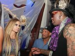 Carmen Electra and Dennis Rodman share some kind words during the Kids Safe fundraiser hosted By Berman & Berman Law Group at the Blue Martini in Boca Raton, FL  Pictured: Carmen Electra, Dennis Rodman Ref: SPL865898  241014   Picture by: Nine / Splash News  Splash News and Pictures Los Angeles: 310-821-2666 New York: 212-619-2666 London: 870-934-2666 photodesk@splashnews.com