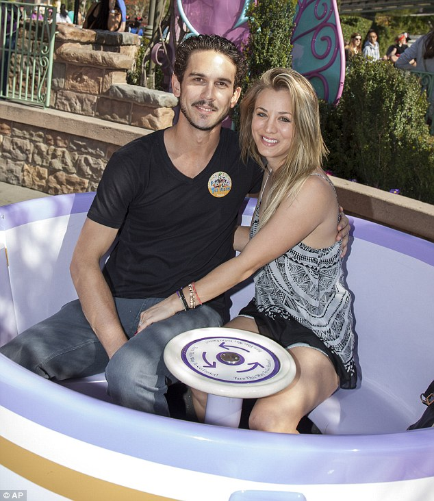 Taking a spin: The newlyweds - who got married on New Year's Eve - posed at the Tea Cup Ride