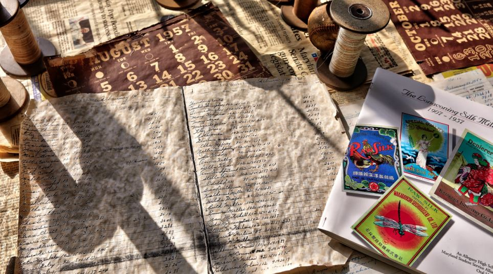 It is clear that much of the paperwork in the abandoned factory has yellowed with age when contrasted with a modern day brochure advertising the historic site