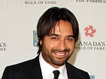 October 18, 2014: Jian Ghomeshi arriving at the 2014 Canada's Walk of Fame ceremony in Toronto, Canada.  Mandatory Credit: INFphoto.com Ref.: infcato-07 sp CODE000