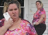 128169, EXCLUSIVE: Mama June Shannon seen for the first the first time since the cancellation of 'Here Comes Honey Boo Boo' outside her house in McIntyre Georgia. June appeared outside the family home as she chatted on her cell phone to her estranged husband Mike 'Sugar Bear' Thompson, who was close to the house sitting in his red truck. Honey Boo Boo stood on the front steps with her mother as she chatted on the phone. Mama June is rumored to be in a relationship with convicted child sex offender Mark McDaniel, leading to the cancellation of their hit reality show. McIntyre, Georgia - Friday October  24, 2014 Photograph: Thibault Monnier, © Pacific Coast News. Los Angeles Office: +1 310.822.0419 London Office: +44 208.090.4079 sales@pacificcoastnews.com FEE MUST BE AGREED PRIOR TO USAGE