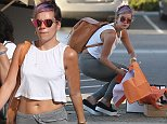 EXCLUSIVE: Lily Allen brought flowers to Chris Martins house and then went shopping in Malibu with friend. Lily managed to buy so much stuff that her bag ripped and spilled her purchases everywhere on October 25, 2014.  Pictured: Lily Allen  Ref: SPL875192  251014   EXCLUSIVE Picture by: Splash News/ Ability Films  Splash News and Pictures Los Angeles: 310-821-2666 New York: 212-619-2666 London: 870-934-2666 photodesk@splashnews.com