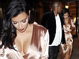 EXCLUSIVE: Kim Kardashian West and Kanye West look stunning as they leave the cinema at The Grove in Los Angeles, California. The happy couple were dressed to the nines, having gone to the cinema straight from a wedding reception. Kim wore a long-sleeved, deep-cut, pink satin gown, slashed to the thigh, while Kanye opted for leather trousers. The duo were reported to have seen the horror movie 'Ouija'. They caused quite a stir at the popular West Hollywood mall, with fans clamoring to get a glimpse of them as they left the theatre.\n\nPictured: Kim Kardashian and Kanye West\nRef: SPL874808  251014   EXCLUSIVE\nPicture by: Splash News\n\nSplash News and Pictures\nLos Angeles:\t310-821-2666\nNew York:\t212-619-2666\nLondon:\t870-934-2666\nphotodesk@splashnews.com\n