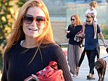 EXCLUSIVE: Patsy Palmer wears very baggy trousers for a sunset stroll in Malibu, California. The Eastenders star, who was smiling and laughing as she walked back from the beach with friends, also wore a thick navy sweater. The actress also carried a small pair of shoes, that matched her own, belonging to youngest son Bertie who rode on husband Richard Merkell's shoulders.   Pictured: Patsy Palmer Ref: SPL872449  261014   EXCLUSIVE Picture by: Splash News  Splash News and Pictures Los Angeles: 310-821-2666 New York: 212-619-2666 London: 870-934-2666 photodesk@splashnews.com
