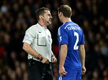 Referee Phil Dowd (left) has words with Chelsea's Branislav Ivanovic before showing him the red card during the Barclays Premier League match at Old Trafford, Manchester. PRESS ASSOCIATION Photo. Picture date: Sunday October 26, 2014. See PA story SOCCER Man Utd. Photo credit should read Martin Rickett/PA Wire. Editorial use only. Maximum 45 images during a match. No video emulation or promotion as 'live'. No use in games, competitions, merchandise, betting or single club/player services. No use with unofficial audio, video, data, fixtures or club/league logos.