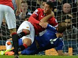 Ivanovic is holding onto Smalling after being dragged down in the area by the Manchester United defender