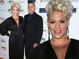 BEVERLY HILLS, CA - OCTOBER 25:  Singer Pink (L) and husband TV personality Carey Hart attend the Share Our Strength's No Kid Hungry Campaign fundraising dinner at Ron Burkle's Green Acres Estate on October 25, 2014 in Beverly Hills, California.  (Photo by David Livingston/Getty Images)