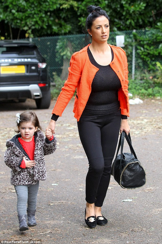 The future's bright the future's orange: Chantelle Houghton steps out with daughter Dolly having had her High Court case against Closer magazine thrown out