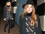 EXCLUSIVE: Actress Lindsay Lohan seen leaving the Playhouse Theatre in London's West End after another performance in the play, 'Speed-the-Plow'. Lindsay slipped out of a side door to try and avoid meeting fans and photographers, but was seen as she exited from the side door. She was photographed wearing a fedora hat with a black suit jacket and trousers, and a black shirt with guns printed all over it.  Pictured: Lindsay Lohan Ref: SPL874330  251014   EXCLUSIVE Picture by: WeirPhotos / Splash News  Splash News and Pictures Los Angeles: 310-821-2666 New York: 212-619-2666 London: 870-934-2666 photodesk@splashnews.com