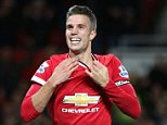 MANCHESTER, ENGLAND - OCTOBER 26:  Robin van Persie of Manchester United celebrates scoring their first goal during the Barclays Premier League match between Manchester United and Chelsea at Old Trafford on October 26, 2014 in Manchester, England.  (Photo by Matthew Peters/Man Utd via Getty Images)