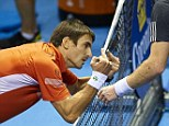 Robredo (left) gives Murray a light-hearted salute after losing in the final of the Valencia Open