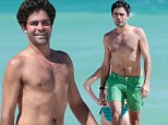 128337, Adrian Grenier goes a shirtless dip while on the beach with his girlfriend in Miami. The Entourage star showed off his toned torso as he hit the ocean to cool down after a jog. Miami, Florida - Tuesday October 28, 2014. Photograph: Brett Kaffee © Pacific Coast News. Los Angeles Office: +1 310.822.0419 London Office: +44 208.090.4079 sales@pacificcoastnews.com FEE MUST BE AGREED PRIOR TO USAGE