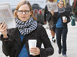 Mandatory Credit: Photo by Startraks Photo/REX (4229232d)\n Jodie Foster\n Jodie Foster out and about, New York, America - 28 Oct 2014\n Jodie Foster hides behind a New York Times while getting coffee\n