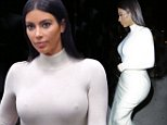 Please contact X17 before any use of these exclusive photos - x17@x17agency.com   Kim Kardashian arrives in all white from a flight in Burbank after her birthday bash in Las Vegas October 27, 2014 X17online.com EXCLUSIVE