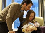 """ADDS LOCATION This photo provided by Clinton spokesman Kamyl Bazbaz shows Chelsea Clinton, her husband Marc Mezvinsky, and their daughter Charlotte Clinton Mezvinsky on Saturday, Sept. 27, 2014, at Lenox Hill Hospital in New York. Chelsea Clinton announced the news of her daughter's birth on Twitter and Facebook early Saturday, saying she and her husband are """"full of love, awe and gratitude.""""  (AP Photo/Office of President Clinton, Jon Davidson)"""