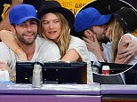 LOS ANGELES, CA - OCTOBER 28:  Adam Levine (L) and Behati Prinsloo attend a basketball game between the Houston Rockets and the Los Angeles Lakers at Staples Center on October 28, 2014 in Los Angeles, California.  (Photo by Noel Vasquez/GC Images)