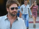 ***MANDATORY BYLINE TO READ INFphoto.com ONLY*** Gerald Butler exits Bui Sushi with a Western gun fighting book after a lunch with mystery girlfriend in Malibu. Could GB researching a Western cowboy role?  Pictured: General View Ref: SPL878160  291014   Picture by: INFphoto.com