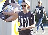 Picture Shows: Kristen Stewart  October 29, 2014    'Camp X-Ray' actress Kristen Stewart stops to pick up some cigarettes from a gas station in Los Angeles, California.     Kristen, who recently revealed that she wants to take a break from acting to focus on other art forms, can be seen with some paint stains on her hands. It looks like Kristen has already begun to make some art!    Exclusive - All Round  UK RIGHTS ONLY    Pictures by : FameFlynet UK    2014  Tel : +44 (0)20 3551 5049  Email : info@fameflynet.uk.com