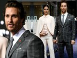 """US actor Matthew McConaughey (R) poses on the red carpet with wife Camila Alves (L) for the European premiere of the film """"Interstellar"""" in London on October 29, 2014.  AFP PHOTO / LEON NEALLEON NEAL/AFP/Getty Images"""