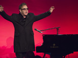 "Elton John performs at the Elton John AIDS Foundation¿s 13th Annual ""An Enduring Vision"" benefit at Cipriani's Wall Street on Tuesday, Oct. 28, 2014, in New York. (Photo by Charles Sykes/Invision/AP)"