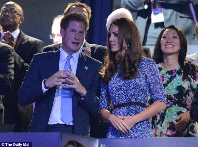 Kate, wearing Whistles, talking with Prince Harry at the Olympic Closing Ceremong in 2012 - incidentally, the woman behind Kate is also wearing Whistles
