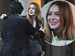30.OCTOBER.2014  - LONDON  - UK *** EXCLUSIVE ALL ROUND PICTURES *** ACTRESS LINDSAY LOHAN IS SPOTTED HAVING SOME DRINKS AT ROKA BEFORE HER STAGE PLAY IN LONDON. LINDSAY HAD TO CANCEL HER SHOW THE PREVIOUS NIGHT AS SHE WAS ILL AND NEEDED REST. MISS LOHAN SPENT ALOT OF TIME ON THE PHONE OUTSIDE ROKA JAPENESE RESTAURANT AND POSED FOR FANS WHO WALKED PAST AND ASKED FOR SELFIES. LINDSAY ALSO SEEMS TO HAVE GROWN A TUMMY SINCE HER STAY IN LONDON BEGAN. BYLINE MUST READ : XPOSUREPHOTOS.COM ***UK CLIENTS - PICTURES CONTAINING CHILDREN PLEASE PIXELATE FACE PRIOR TO PUBLICATION *** **UK CLIENTS MUST CALL PRIOR TO TV OR ONLINE USAGE PLEASE TELEPHONE  442083442007