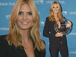 BOSTON, MA - OCTOBER 30:  UNICEF Supporter, Honoree Heidi Klum poses with her 2014 Children's Champion Award as she attends the 2014 UNICEF Children's Champion Award Dinner at The Four Seasons Hotel on October 30, 2014 in Boston, Massachusetts.  (Photo by Paul Marotta/Getty Images for UNICEF)