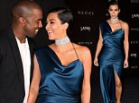 LOS ANGELES, CA - NOVEMBER 01: Recording artist Kanye West (L) and Kim Kardashian West attend the 2014 LACMA Art + Film Gala honoring Barbara Kruger and Quentin Tarantino presented by Gucci at LACMA on November 1, 2014 in Los Angeles, California.  (Photo by Frederick M. Brown/Getty Images)