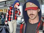 Picture Shows: Ryan Gosling  November 01, 2014\n \n Actor and new dad Ryan Gosling is seen arriving on a flight at LAX airport in Los Angeles, California.\n \n The Hollywood heartthrob has been away filming a new movie, 'The Nice Guys' in Atlanta, Georgia; having to leave his baby girl Esmeralda at home with her mother Eva Mendes.\n \n Non Exclusive\n UK RIGHTS ONLY\n \n Pictures by : FameFlynet UK © 2014\n Tel : +44 (0)20 3551 5049\n Email : info@fameflynet.uk.com
