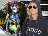 Heidi Klum arriving at Los Angeles International Airport wearing sunglasses and a hoodie with the word 'Cloud' written across the chest\nFeaturing: Heidi Klum\nWhere: Los Angeles, California, United States\nWhen: 02 Nov 2014\nCredit: WENN.com