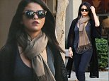 Picture Shows: Selena Gomez  November 02, 2014\n \n Singer and actress Selena Gomez stops by Starbucks with a friend in Los Angeles, California. Selena looked cute and casual in a beige scarf with a long black cardigan, black skinny jeans, and ankle boots.\n \n Non Exclusive\n UK RIGHTS ONLY\n \n Pictures by : FameFlynet UK © 2014\n Tel : +44 (0)20 3551 5049\n Email : info@fameflynet.uk.com