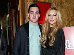 "NEW YORK, NY - DECEMBER 16:  Michael Lohan Jr. and Lindsay Lohan attends the ""Just Sing It"" app launch event at Pravda on December 16, 2013 in New York City.  (Photo by John Lamparski/WireImage)"