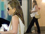 UK CLIENTS MUST CREDIT: AKM-GSI ONLY EXCLUSIVE: Jennifer Aniston looks amazing as she leaves the Carasoin Day Spa & Skin Clinic in Los Angeles and leaves carrying a bag of product. **Shot on October 30, 2014**  Pictured: Jennifer Aniston Ref: SPL881014  021114   EXCLUSIVE Picture by: AKM-GSI / Splash News