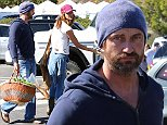 Please contact X17 before any use of these exclusive photos - x17@x17agency.com   Gerard Butler looking worn out shopping for produce at the Malibu Farmers Market with his myster girlfriend.  November 2, 2014 X17online.com EXCLUSIVE