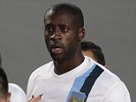 Manchester City's Yaya Toure (C) listens to CSKA's Kirill Nababkin (L) during the Champions League group D soccer match between CSKA Moscow and Manchester City, at Arena Khimki stadium outside Moscow, Russia.  Manchester City midfielder Yaya Toure called on UEFA to take action against CSKA Moscow after he was subjected to racist chanting during his team's 2-1 win in the Champions League. The Ivory Coast player said he had told match referee Ovidiu Hategan about the chants during the game in the Russian capital.    In this photo taken on Wednesday, Oct. 23, 21013, Manchester City's Yaya Toure, center, listens to CSKA's Kirill Nababkin, left, during the Champions League group D soccer match between CSKA Moscow and Manchester City, at Arena Khimki stadium outside Moscow, Russia, on Wednesday, Oct. 23, 2013. Manchester City midfielder Yaya Toure called on UEFA to take action against CSKA Moscow after he was subjected to racist chanting during his team's 2-1 win in the Champions League. Th