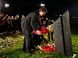 LONDON, ENGLAND - NOVEMBER 03: Ben Smith of the New Zealand All Blacks places a wreath at the New Zealand Memorial at Hyde Park corner November 3, 2014 in London, England. Members of the All Blacks, New Zealand High Commissioner, Sir Lockwood Smith and other New Zealand representatives paid their respects to New Zealanders who died in World War 1.  (Photo by Phil Walter/Getty Images)