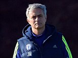 Chelsea's Portuguese manager Jose Mourinho (2nd L) is pictured during a training session for the forthcoming UEFA Champions League, group G football match against NK Maribor at Chelsea's training ground in Cobham, south of London, on November 4, 2014. AFP PHOTO / GLYN KIRKGLYN KIRK/AFP/Getty Images